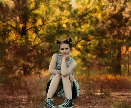 girl-sitting-posing-trees-medium