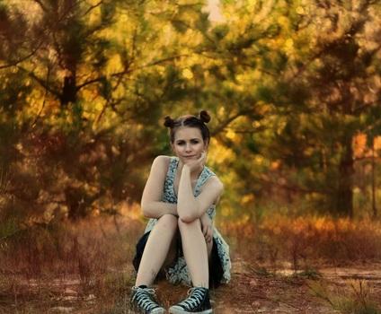 girl-sitting-posing-trees-medium